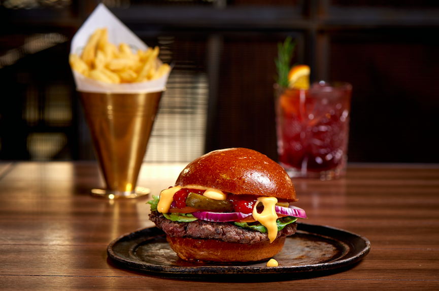 Modern Luxury in the Capital - Hilton London Bankside: The towering chunky Aberdeen Angus beef burgers stuffed with streaky bacon and Red Leicester Cheese at The Distillery