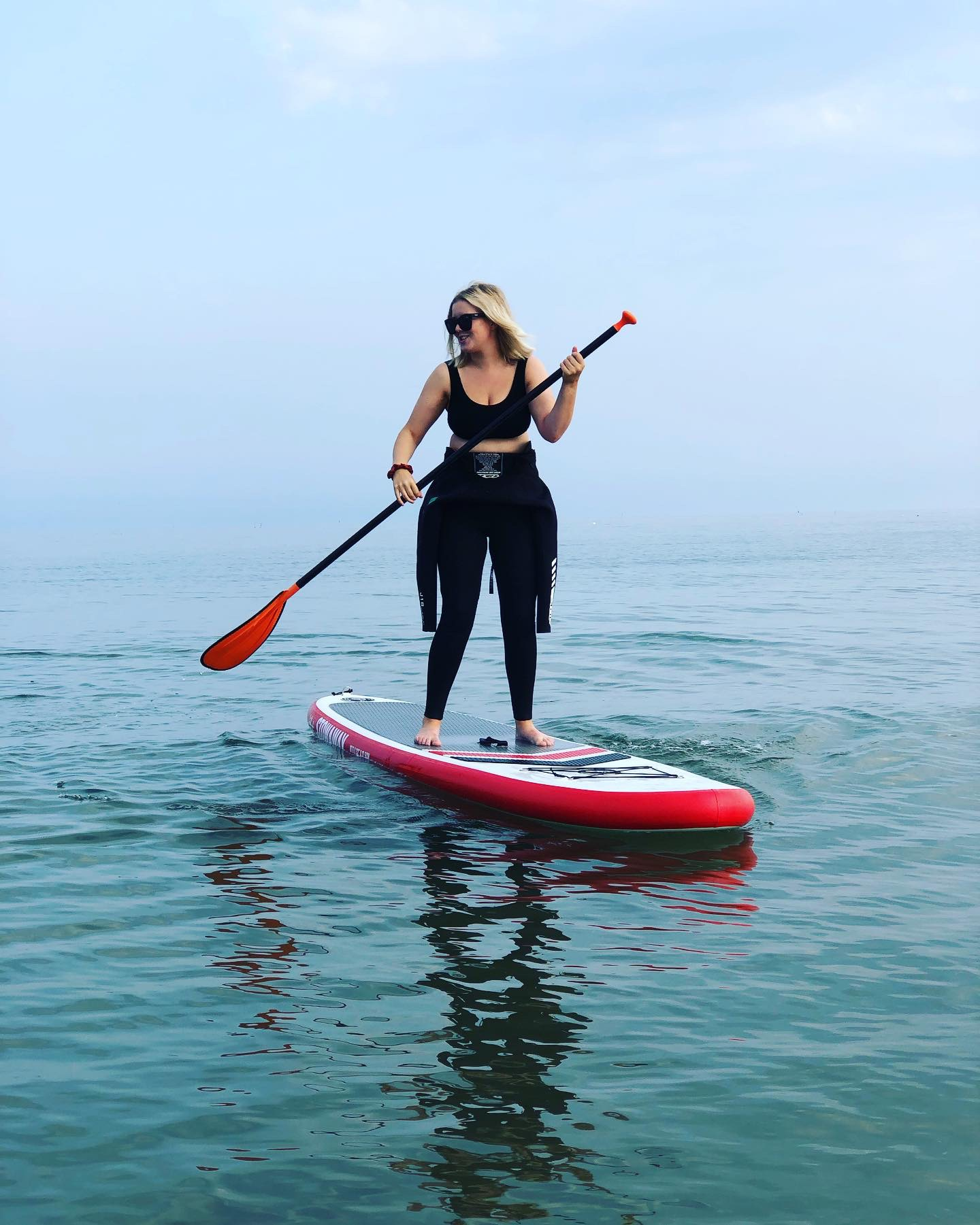 Learn to Surf in Northumberland with Northside Surf School - woman stand up paddleboarding in Northumberland