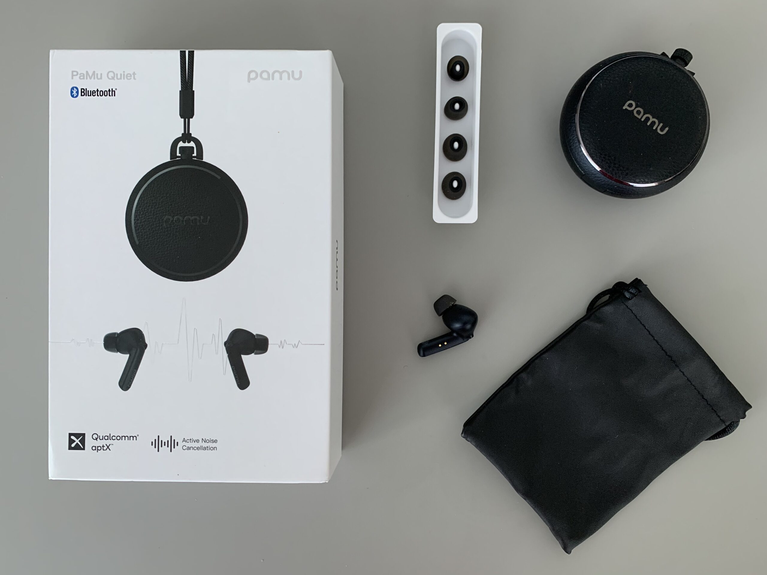 Christmas Gifts For Him: PaMu earphones are stylishly packaged and include three ear tip sizes for total comfort, lanyard, carry case, charging case and charging cable