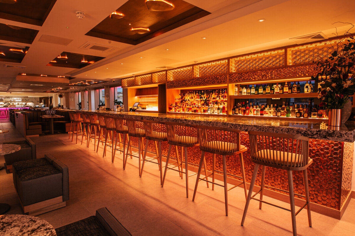 The gorgeous indoor space at Bisushima includes a full bar area